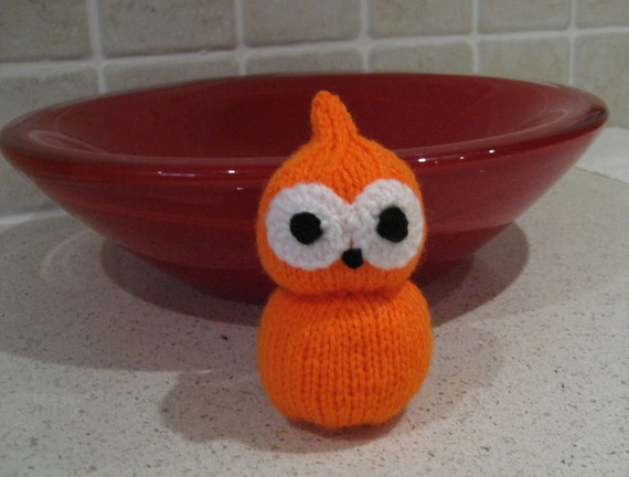 Zingy the flame, cute hand knitted soft toy.