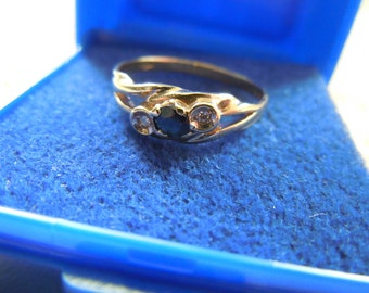 Vintage English Gold Ring Hallmarked with diamonds and sapphire circa 80s
