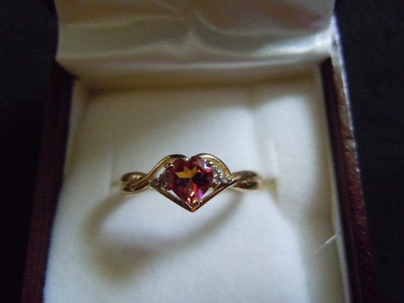 Vintage English yellow gold ring with orange topaz and accent diamonds