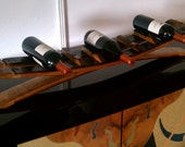 Wine Rack made from recycled wine barrels.