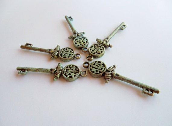 Five Brass Shabby/Vintage  Inspired Oriental Design Key Charms
