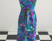 1970s Mod Exotica Polynesian lounge dress in cool floral pattern with amazing pleated trim