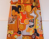 1960s Totally Mod short A line dress in a vivid warm-toned polished cotton fabric with jumbo welts
