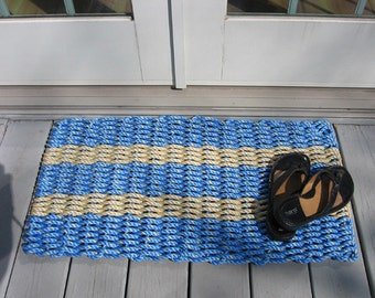 blue and tan handwoven doormat from lobster trap rope.