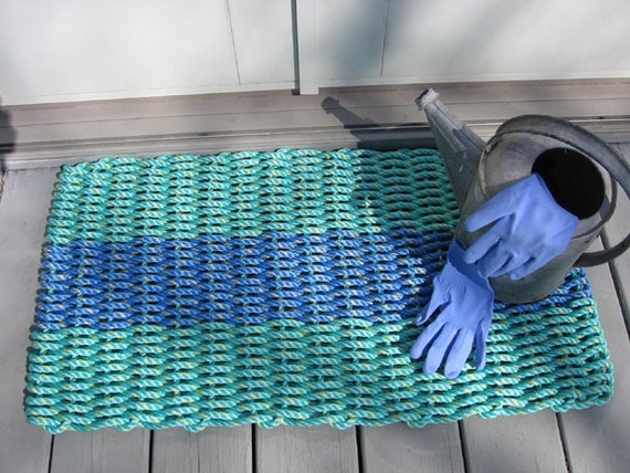 blue and aqua  handwoven doormat from lobster trap rope.