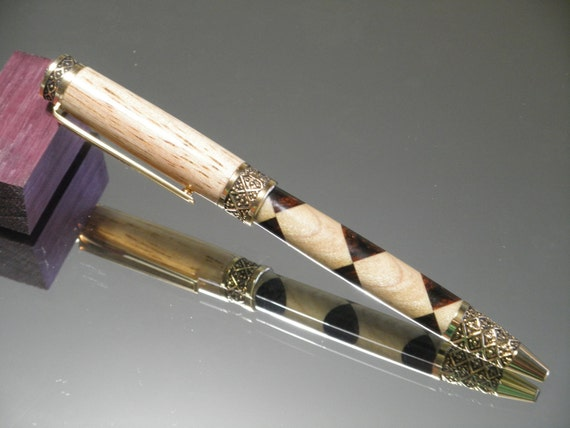 Wood Pen: light checker and circle harlequin wood pen in sculptured gold setting