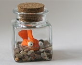Polymer clay fish in corked jar