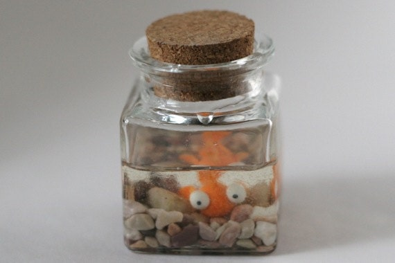 Submerged polymer clay goldfish in jar with cork