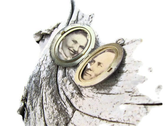 Antique 1930s sterling locket with original photos, simple floral etching and long gone loving couple by Good Mourning Shop