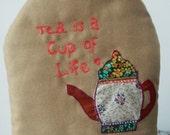 applique tea cosy