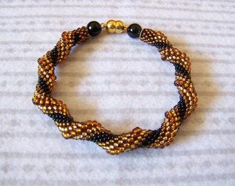 Spiral bracelet in golden, amber and black - Cellini Spiral Beadwoven Bangle Bracelet - Twisted bracelet - beaded jewelry - Modern bracelet