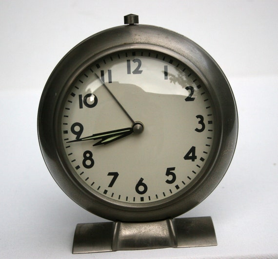 Vintage Silver Bedside Analog Clock with Arms that glow in the night Round Space age Mid Century Heavy Home Decor