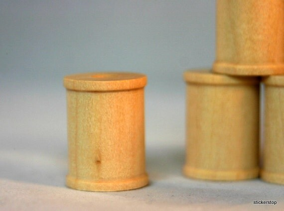 "24 Wooden Spools 1"" tall  x 3/4"" wide with 1/4"" hole"