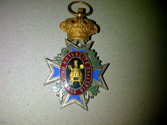 antique enamel crown pendant in the shape of a cross
