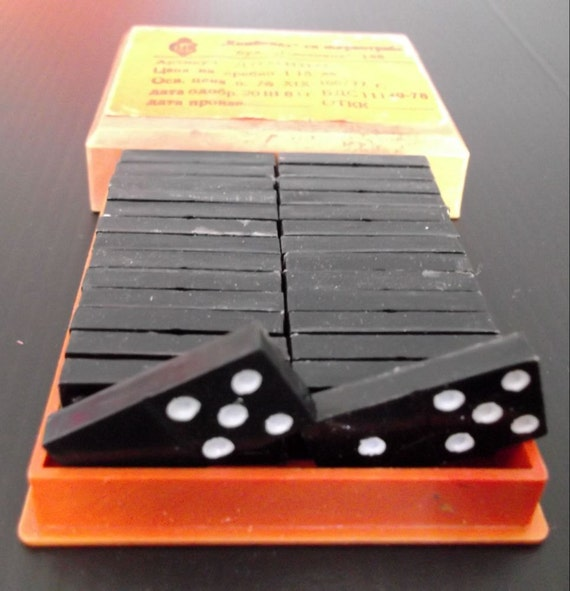 Vintage complete black Dominoes set, in box.    Game    Mixed media    Supplies