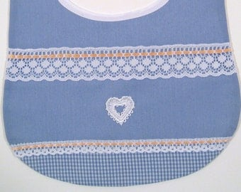Baby bib in blue fabric, accented with a heart applique, gingham fabric,  peach ribbon, and lace.