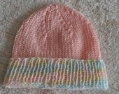 Pink knitted beanie hat for toddlers or little girls