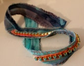 Hand painted silk wrap bracelet with rough edge and turquoise stones