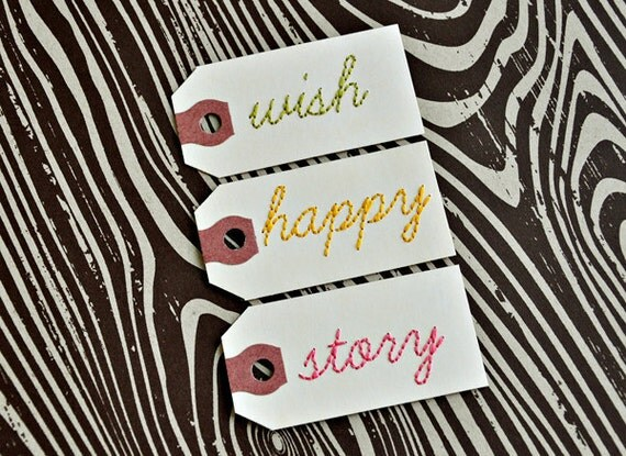 Set of three handstitched tags. WISH, HAPPY,STORY.