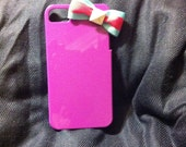 Purple 4/4s iphone case with a stylish babyblue & pink bow topping it off with a white stud.