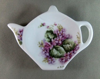 Hand painted double violets on a porcelain teabag caddy
