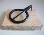 Sicilian jews harp marranzano in iron with a lovely wooden structure decorated with linen.