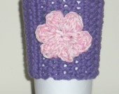 purple coffee cozy with pink flower at The Cozy Store