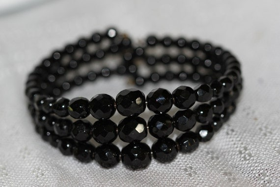 Vintage black graduated bead three strand bracelet.  These classy faceted beads are still in style.