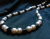 REDUCED Classic beauty, an elegent black glass and vintage glass pearl necklace.