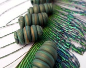 Asymmetrical peacock coloured barrel swirl beads - set of 6