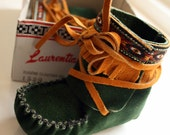 Green and tan leather baby moccasin slippers