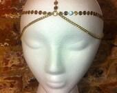 Women's golden ladie head piece jewelry