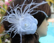 Very  cute white  color  beaded flower with feather