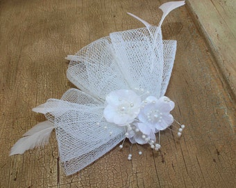 White   color  flower clip with  feather