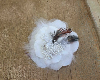 Very  cute white    color   flower with feather  back pin and clip