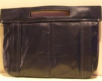 Nice dark blue leather vintage handbag, clutch with double open worked handles . Seventies