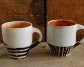 Pair of black and white striped mugs