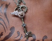 Steampunk Brass Key Pendant with Flowers, Wing and Butterfly OOAK
