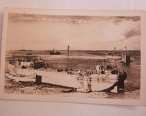 Vintage Japan postcard Typhoon Wake Naha Okinawa with freighter RPPC