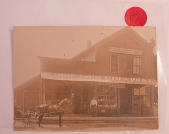 Victorian Western Photo Postcard RPPC Largest Country Store in Erie Pennsylvania L.H.Raymond General store