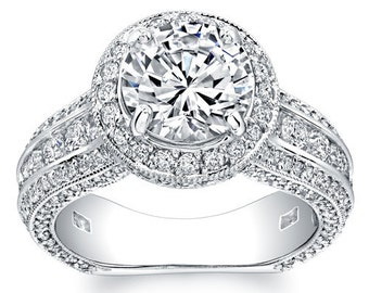 Ladies 14kt white gold round diamond halo engagement ring 1.50 ctw G-VS2 diamonds and 1.50ct Round White Sapphire center