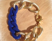The MACKENZIE: Chunky Gold Textured Copper Plated Chain Linked With A Cobalt Blue Resin Chain