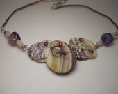 Beautiful shades of purple shells and wire wrapped necklace