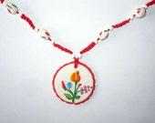 Crochet necklace with original hungarian kalocsai motif