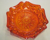 vintage, large and rare 6 sided orange amberina moon and star ashtray / dish