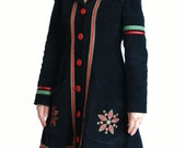 Black corduroy jacket / coat with embroidered motifs and ribbons.