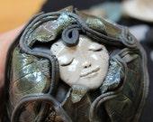 Raku Leaf and Face Sculpture