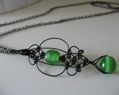 Black Knotted Wire Drop Pendant with Green Glass Beads