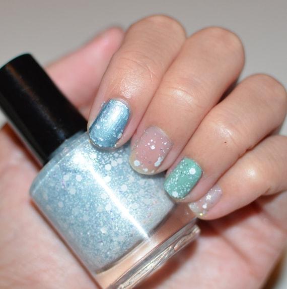 Blue Nail Polish One Finger: Nail Polish: Powder Puff Light Blue Base With White Glitters