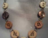 Stylish beige natural tone button necklace